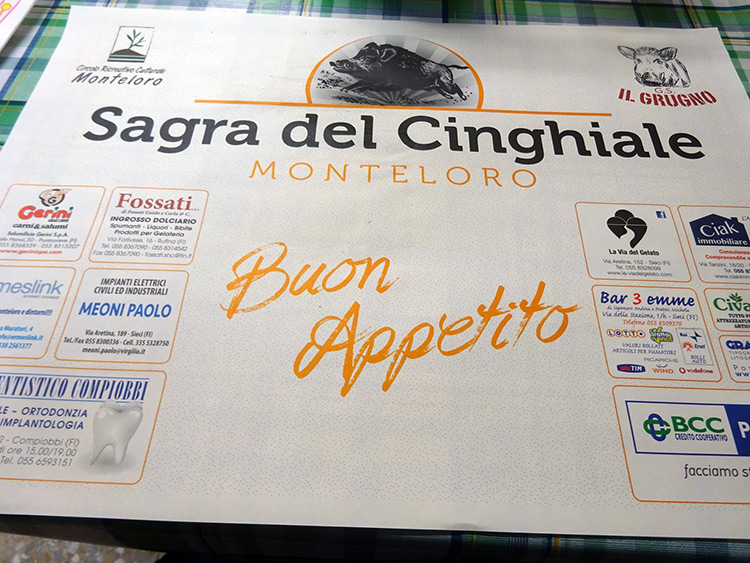 Buon appetito on the table cloth of Monteloro sagra